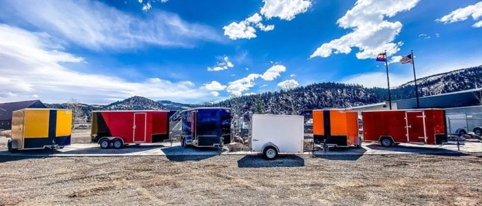 Pace American and Look Trailers Yellow, Red two tone, blue, white, and orange trailers